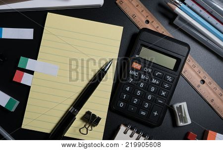 Close Up Of Office Business Supplies On Black Background In Studio. Basic And Classic Office Busines