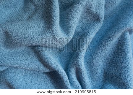 Folded sky blue fabric without prints or patterns