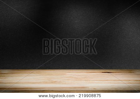 empty wooden on black backdrop with spotlight. Wood table top. can used for display or montage your products
