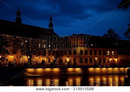 Odra River in a beautiful old city of Wroclaw, Poland with illumination of vintage night lanterns on the Tumsky Island