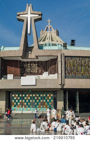 VILLA OF GUADALUPE MEXICO CITY DECEMBER 04 2017 - Pilgrims from the state of Chiapas Mexico take a break in front of the main entrance of the New Basilica of Guadalupe.