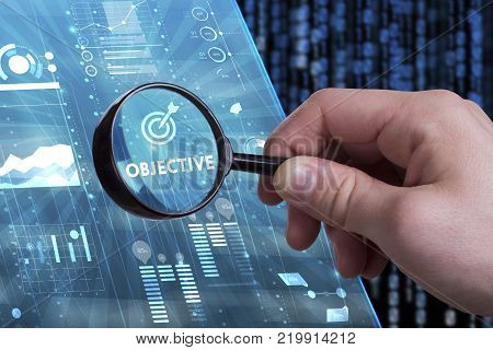 Business Technology Internet and network concept. Young businessman working on a virtual screen of the future and sees the inscription: Objective