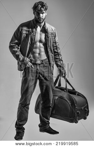 Muscular Bearded Man With Sexy Body Holds Big Bag, Suitcase