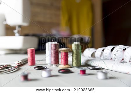 sewing sewing on the sewing machine sewing supplies colored sewing threads centimeter tailors scissors buttons