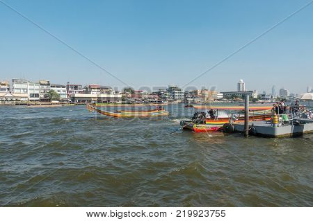 BANGKOK THAILAND - December 22 2017: Chao Phraya River and Long Tail Boat Tourist Peer. Long-tail boat is very popular transportation for people or tourists traveling and visiting place along the riverside in Thailand.