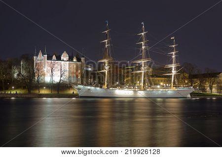 STOCKHOLM SWEDEN - DEC 27 2017: Nightscape of the beautiful sailing ship and hotel Af Chapman in central Stockholm in Sweden December 27 2017