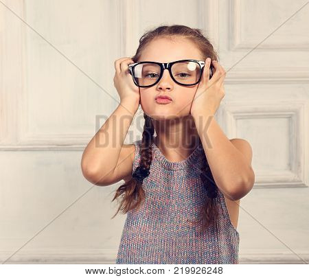 Happy Positive Thinking Kid Girl In Fashion Glasses With Excited Emotional Face Looking Up On Studio