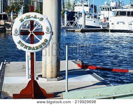 Gold Coast Australia - July 25. 2010: The ceremonial life ring from Warship Bundaberg positioned on the Southport Yacht Club Marina wharf next to the ship's boarding ladder during a visit to the Gold Coast in Main Beach Gold Coast Queensland Australia.