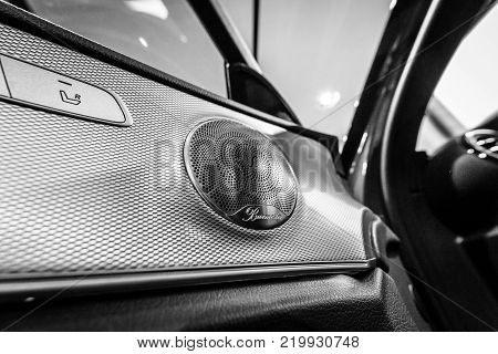 BERLIN - DECEMBER 21, 2017: Showroom. Speaker of the executive car Mercedes-Benz E-Class E220d (W213). Close-up. Black and white. Since 2017.