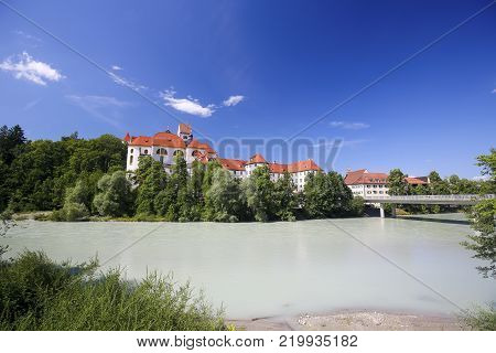 Monastery And Lech River In Fussen In Bavaria, Germany