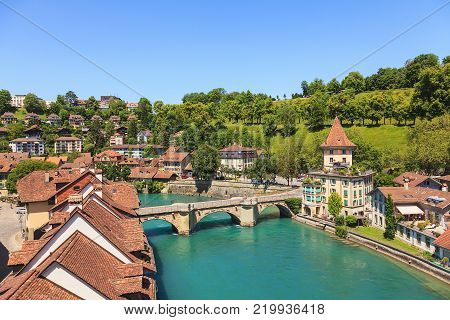Bern, Switzerland - 11 June, 2014: view of the city from the Nydeggbruecke bridge in summertime. The city of Bern is the capital of Switzerland and the fourth most populous city in the country.
