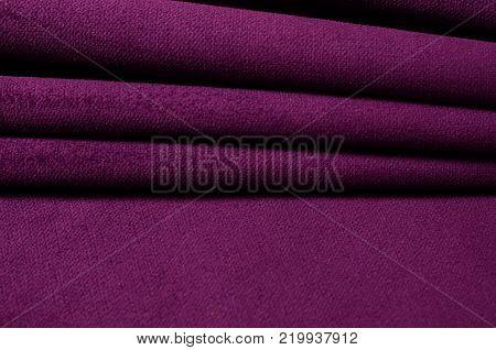 Bright ultraviolet velour textile. Fabric texture background