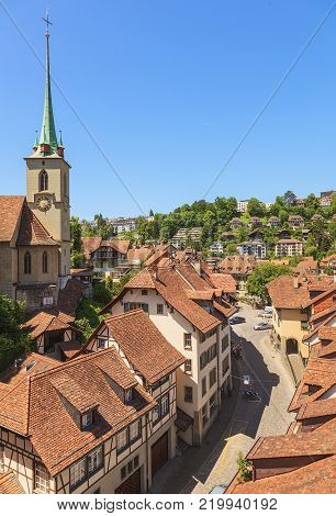 Bern, Switzerland - 11 June, 2014: summertime view of the old town of the city. The city of Bern is the capital of Switzerland and the fourth most populous city in the country.
