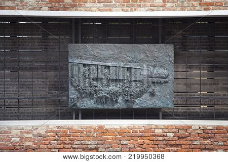VENICE, ITALY - SEPTEMBER 23, 2017: Venetian Ghetto, wall with carved relief on bronze plate, memorial to Venetian Jews.Ghetto was founded in 1516 in the times of the Republic of Venice. It was the first ghetto in the world