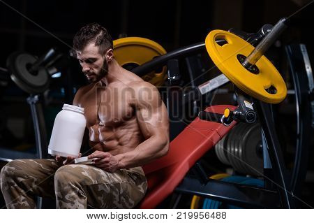 sexy strong bodybuilder athletic fitness man pumping up abs muscles workout bodybuilding concept background  muscular bodybuilder handsome men doing fitness health care exercises in gym naked torso