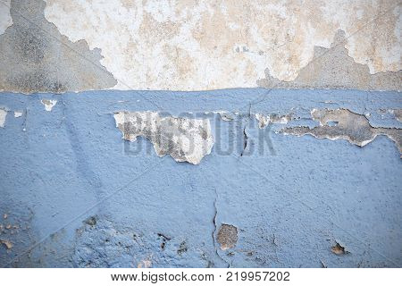 Dark Plaster Wall With Dirty White Background and old Brickwall With Peel Grey Stucco Texture. Retro Vintage Worn Wall Wallpaper. Decayed Cracked Rough Abstract Banner Surface.