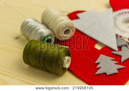 Making handmade toy toys from felt by one's own hands. Children's concept. Cut out details for the manufacture of toys. Winter holidays.