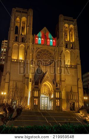 Editorial SS: San Francisco, California - December 28, 2017: Exterior of Grace Cathedral Churchlandmarks, cemetery, tourism, design, architectural, vertical, usa, ghiberti doors, stairs, frontier, labyrinth, history, art, catholic, gothic, holiday lights,