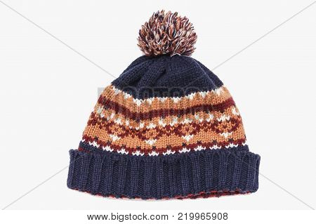 knitted hat isolated on white background .hat with pompon . hat red.