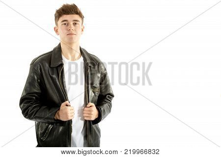 18 year old wearing a leather jacket and jeans isolated on white background
