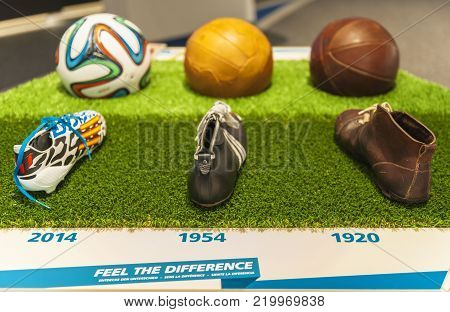 Zurich, Switzerland - April 2017: evolution in soccer ball and shoes at the exposition of FIFA official museum