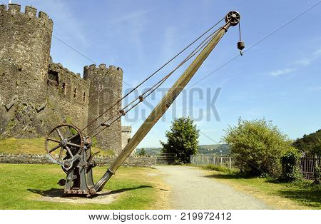 Conwy, Wales, United Kingdom - June 22, 2014 : Old lifting equipment used during the Industrial revolution outside Conwy castle