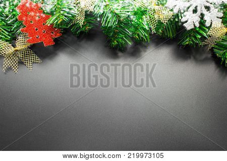 Christmas background with copy space for product montage or text message. xmas tree on black table