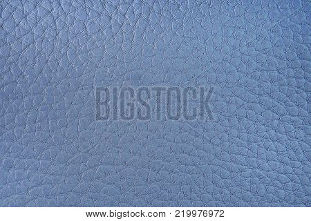 Texture of artificial leather. Light blue background or leatherette backdrop.