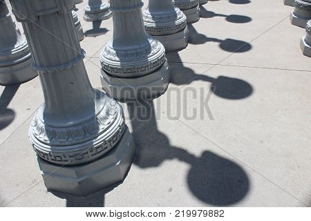 Image of streetlights and shadows on a street in Los Angeles.