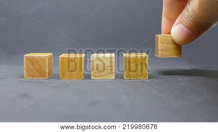 isolated wood cubic in a row , gray background