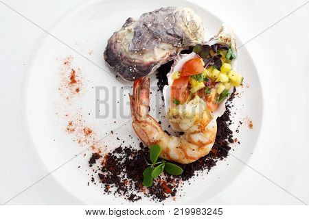 Seafood. Fried grilled shrimp prawns with molluscs on white plate