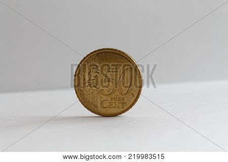 One euro coin on isolated white background Denomination is fifty euro cents