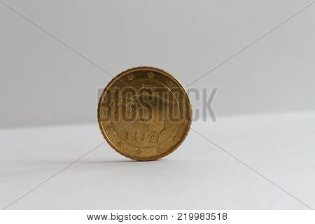 One euro coin on isolated white background Denomination is 50 euro cents - back side
