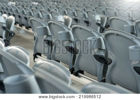 White Plastic Folding Empty Red Seats In Concert Or Football Stadium. Row Of Football Sport Stadium