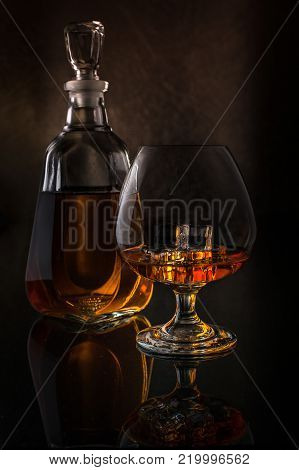 Glass Of Whiskey On Rocks And Crystal Decanter