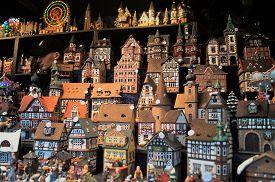 Cologne, Germany - December 16, 2017: Christmas village vendor at the Christmas Market. A vendor sells authentic handmade European Christmas village sets at the Christmas market.