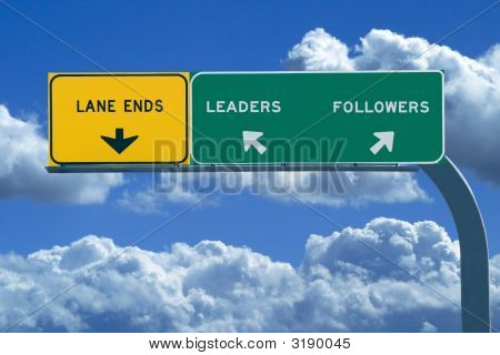 Freeway Sign In Blue Cloudy Skies Reading Leaders And Followers