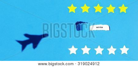 Oblong torn hole from right to left in green sheet of paper with shadow and paper curl. White resulting background with word SERVICE. Yellow and white stars. Shadow of the plane. Review of air company concept. Banner. Copy space