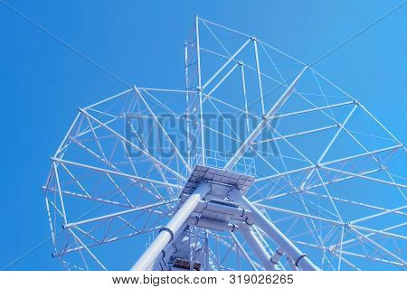 Set Up Of Ferris Wheel In Amusement Park On Sky Background, Closeup.