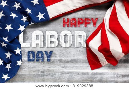 US American flag on worn white wooden background. For USA Labor day celebration. With Happy Labor Day text.