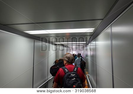 Orlando, Fl/usa-8/22/19: People Waiting On A Jetway To Board An Airplane.