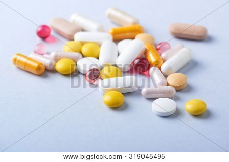 Vitamins And Supplements On Bright Paper Background. Concept For A Healthy Dietary Supplementation.