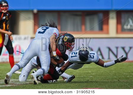 VIENNA, AUSTRIA - JULY 16 RB Jerome Morris (#31 Germany) is tackled at the Football World Championship on July 16, 2011 in Vienna, Austria.