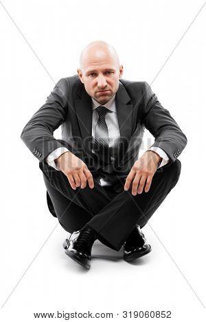 Business problems and failure at work concept - unhappy tired or stressed businessman in depression sitting down floor white isolated