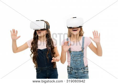Virtual Reality Lets You Travel Without Leaving The Room. Small Children Using Virtual Reality Devic