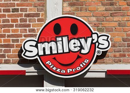 Stade, Germany - August 22, 2019: Signage at wall identifying a Smiley's pizza delivery service branch