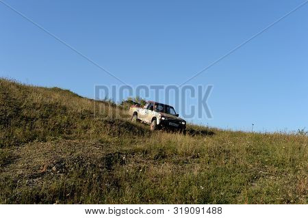Altai Region, Russia - September 5, 2018:japanese Pickup Datsun 720 In The Foothills Of The Altai Mo