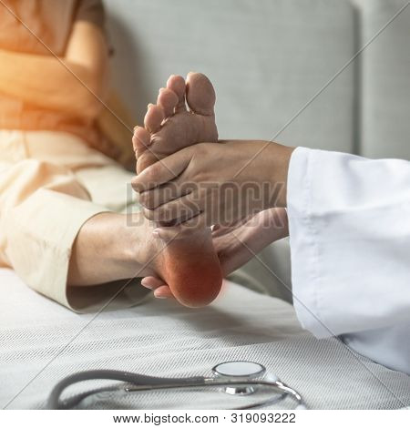 Plantar Fasciitis Or Heel Pain Illness In Feet Of Woman Patient Who Having Medical Exam With Orthopa