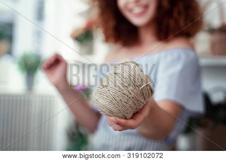 Smiling Short-haired Girl Showing Hunk Of String