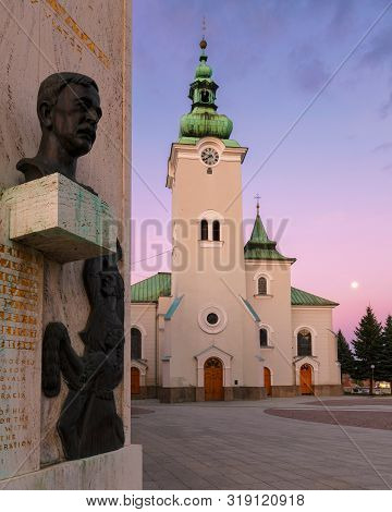 Ruzomberok, Slovakia - April 18, 2019: Memorial And A Church In The Main Square Of Ruzomberok.